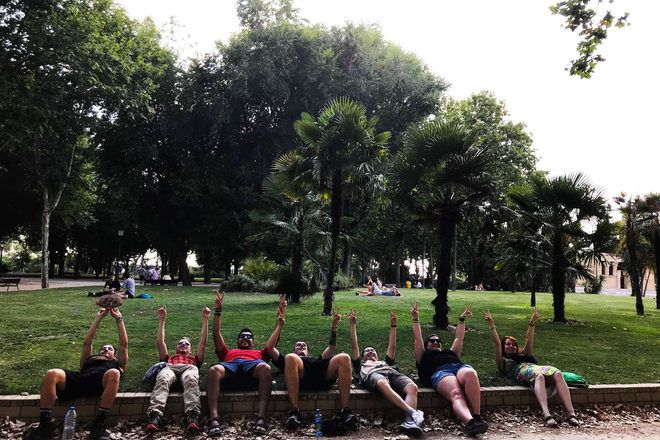Travelers doing a funny picture in a park during a guruwalk in the Spanish capital, Madrid.