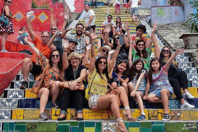Group of travelers taking a picture together during a free walking tour in Rio, Brazil.