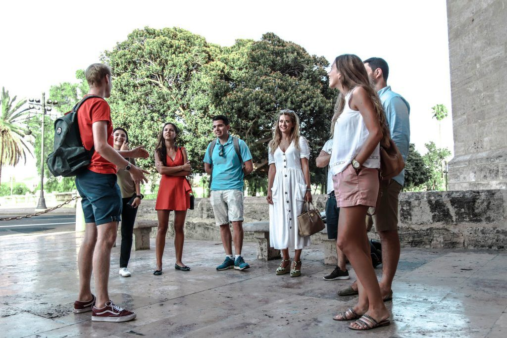 A guide explaining to travelers during a guruwalk