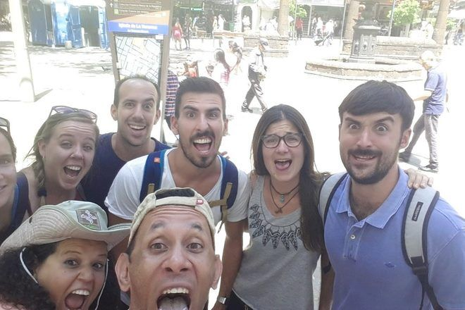 Travelers taking a selfie of grimaces during a guruwalk in Medellin, Colombia.