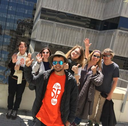 Group of travelers saying hello during a free walking tour in San Franscico.
