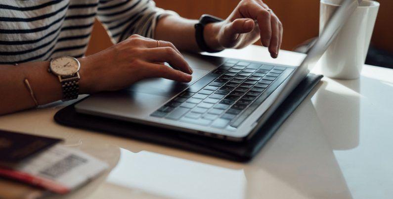 Women writing on a laptop.
